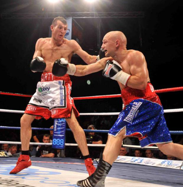 REMATCH: Derry Mathews, left, in action against Gavin Rees last year