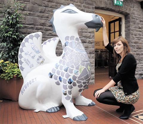 South Wales Argus: VIEW OVER THE CITY: Meet the SuperDragon of the South Wales Argus created by artist Lauren Brown and now on display at the café in Belle Vue Park, Newport