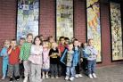 MOSAIC UNVEILED: Children from Don Close nursery School in front of the mosaics they helped create with community artist Granville John
