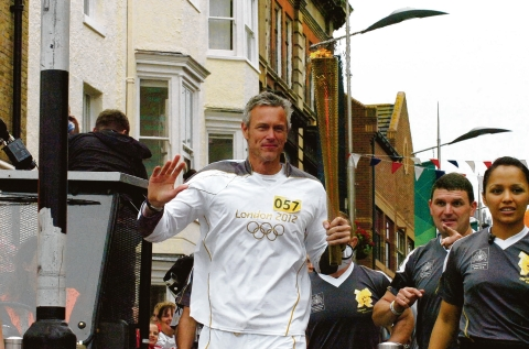 Mark Foster carrying the Olympic flame through Southend last week