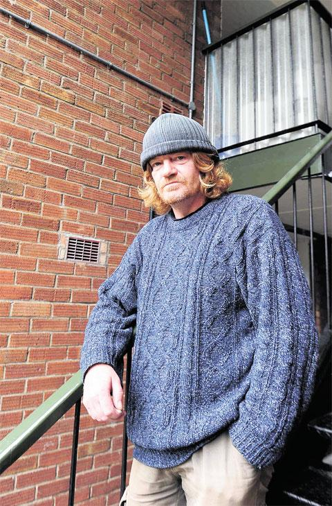ANGRY: Phil Reid, 48, a Bron Afon leaseholder, in Pontynewydd Walk, Northville, Cwmbran. He's received a bill for £3,000 and says he would rather sell his flat than pay