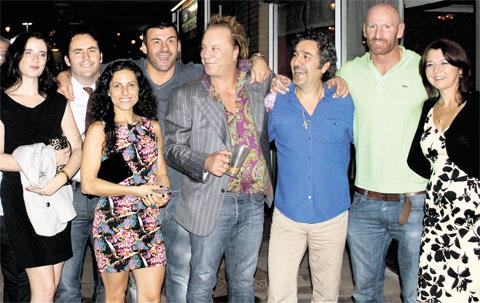OUT IN THE CITY: From left, Alison Watkins, Dan and Nikki O'Connell, Joe Calzaghe, Mickey Rourke, restaurant owner Tony Castaldo, Gareth 'Alfie' Thomas, and Cheryl Castaldo outside Rossini's on Clarence Place