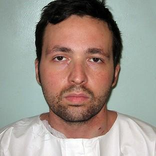 Attila Ban, 32, a hotel receptionist, has been convicted of murdering two colleagues and hiding under a bed containing one of the bodies