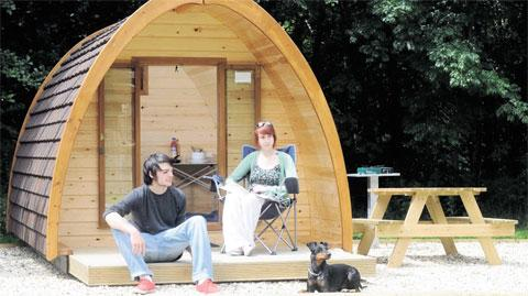 GLAMPERS: Morvan Peresse from Brittany and Bethan Parr from Gelligaer try out one of the Glamping Pods at Cwmcarn Forest Drive