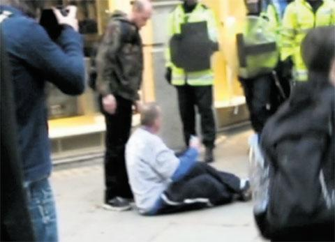South Wales Argus: RIOT SCENE: Ian Tomlinson is left on the floor after being pushed by PC Harwood