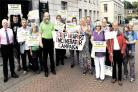 OVERJOYED: Protesters outside Newport Civic Centre yesterday make their feelings known about the proposed incinerator