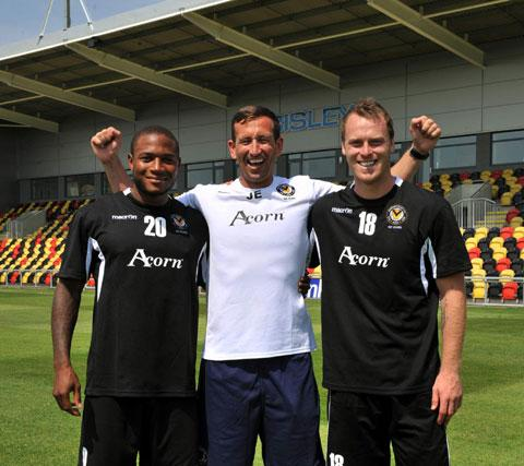 WELCOME: Aaron O'Connor, left, pictured with boss Justin Edinburgh and fellow new signing Mike Flynn is delighted that County will be playing at Rodney Parade