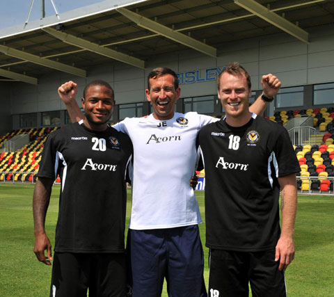 WELCOME: Aaron O'Connor, left, pictured with boss Justin Edinburgh and fellow new signing Mike Flynn is delighted that County will be playing at Rodney
