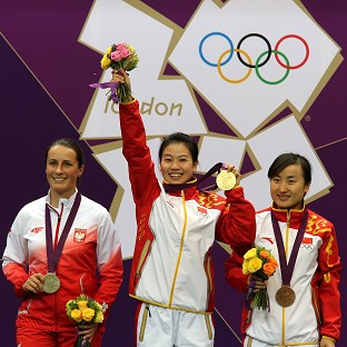 Yi Siling, centre, made history by