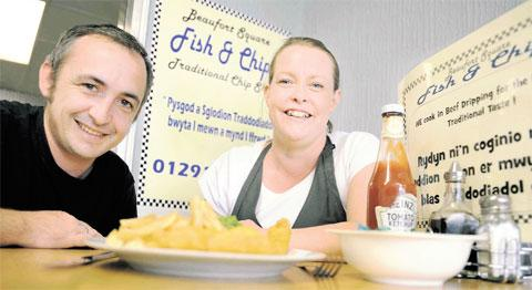 CROESO: Keith and Sarah Beynon of the Beaufort Square chip shop in Chepstow, which will display signs in both Welsh and English