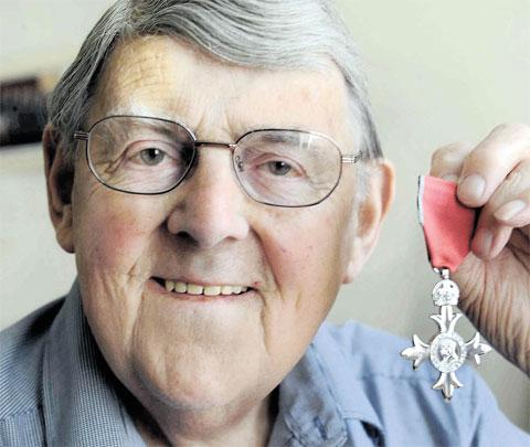STEPPING DOWN: Walford Hutchings with his MBE, awarded at the beginning of last year
