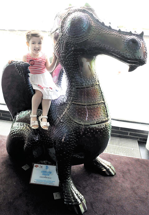 ON THE TRAIL: Above, Grace Noble, two, says her favourite is the chameleon dragon