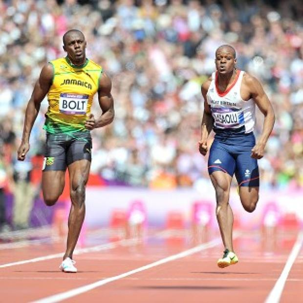 Usain Bolt (left) in action with Great Britain's James Dasaolu
