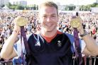WORTH HIS WEIGHT IN GOLD: The fabulous Chris Hoy shows off his Olympic medals
