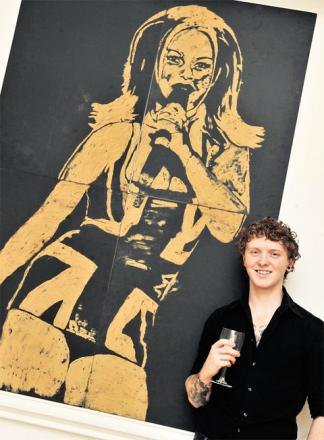 PORTRAIT: Nathan Wyburn with his portrait of 'Ginger Spice' Geri Halliwell, done in ground ginger