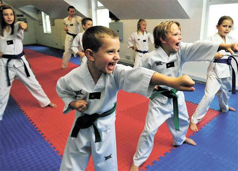 NEXT GENERATION: Matthew Winchester, six, and his classmates at the Fighting Fit Martial Arts and Fitness Centre, Griffithstown, which has seen a boost in membership as a result of the Olympic coverage