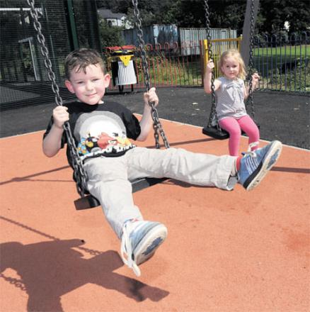 UP AND AWAY: Evan Cooper, six, and his sister Seren, three, from Lower Machen