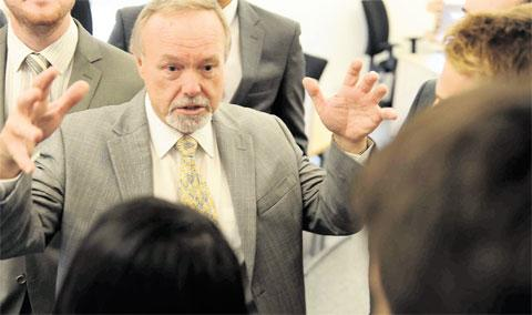 SEIZE THE MOMENT: Sir Terry Matthews chats with IT and science graduates at the official opening of the Alacrity