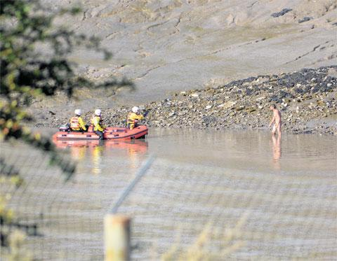 RESCUE: Argus reader Harry Wilkins took this photograph of a naked man being rescued from the River Usk near Castle Bingo in Newport yesterday