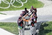 OLYMPIC DUTY: Nurse Jess Arthurs, circled, and her medical colleagues stretcher off a BMX rider injured in one of the heats