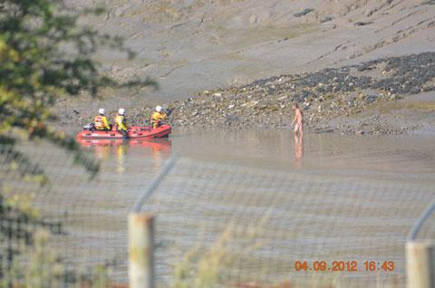 RESCUE: The naked man in the River Usk in Newport on Tuesday