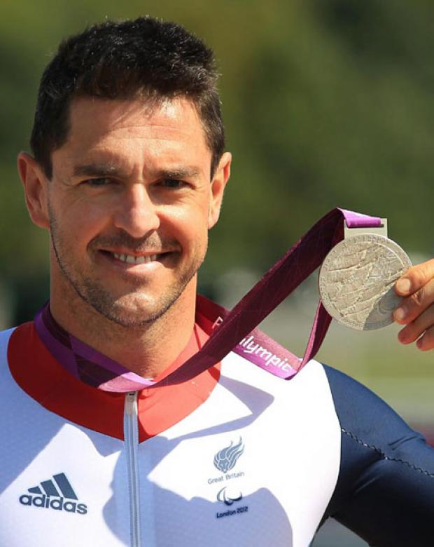 Tredegar Paralympic medallist Mark Colbourne meets the Queen at Buckingham Palace