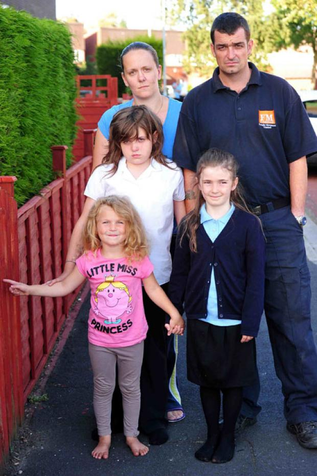 Caitlyn with sisters Kacie, eight and Chloe 10 with mum Tammy and dad Rob