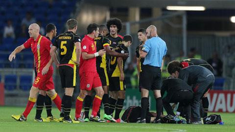 HE'S OFF: Newport's James Collins, left, gets a red card during tonight's clash between Wales and Belgium after a tackle on Guillaume Gillet