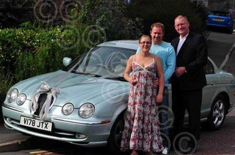 GRATEFUL: Kirsty Jones with fiance Colin and Fred Wildgust with one of his wedding cars