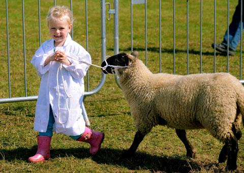 Kate Perkins, four, and her pet lamb Ruby