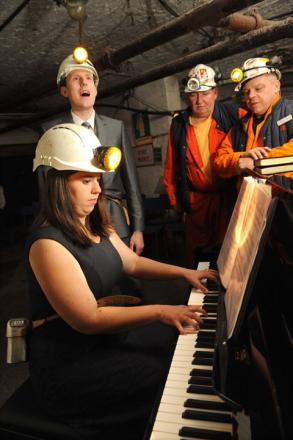 MUSIC MINE: Dan and Laura Curtis, performing, watched by Big Pit guides Barrie Stevenson and Peter Richings