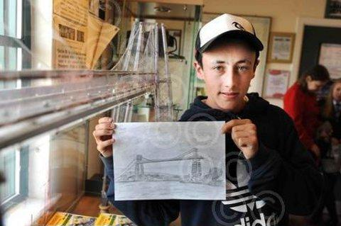 Josh Murphy with his drawing of Newport's Transporter Bridge