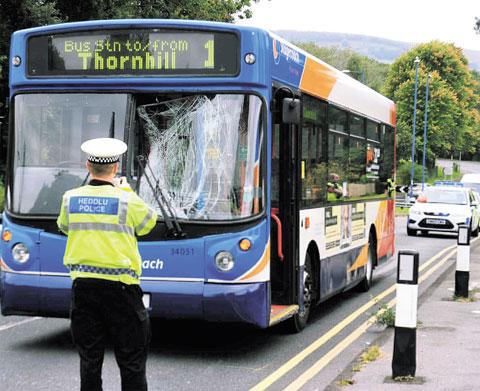 COLLISION: The bus which hit the 17-year-old boy near the Working Men's Club in Chapel Street, Pontnewydd