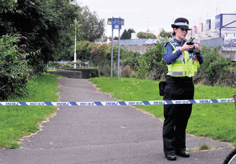 SCENE: A PCSO guards the place where a man's body was found in Cwmbran