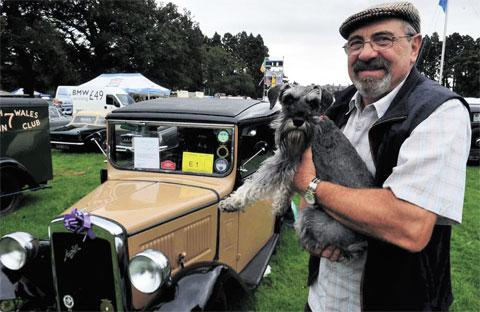 ENTHUSIAST: Brian Bedford with his dog Ruby and a 1934 Austin Box which originated from Newport
