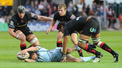 READY TO POUNCE: Dan Lydiate, Jon Evans and Toby Faletau have their eyes on the ball at the breakdown against Cardiff Blues  Picture: MARK LEWIS