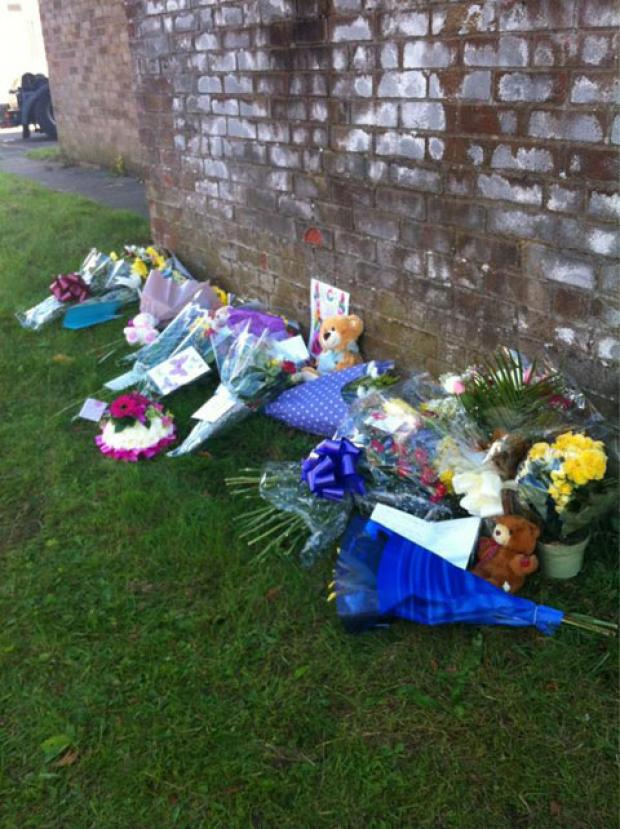 South Wales Argus: TRIBUTES: Flowers left on Tallsland, Coed Eva, Cwmbran after fire killed Mother Kayleigh Buckley, baby Kimberley Buckley and grandmother Kim Buckley.