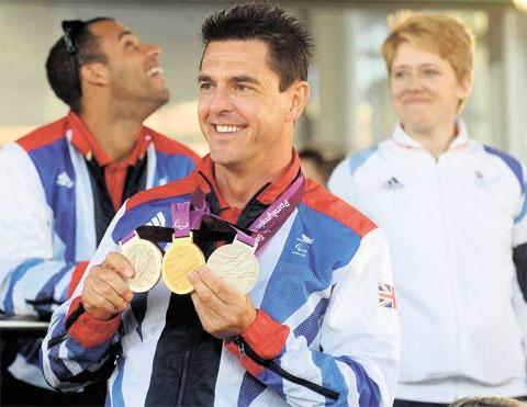 SPORTING HERO: Paracyclist Mark Colbourne will get a homecoming parade in his home town of Tredegar following his tribute at the Senedd along with fellow athletes last Friday