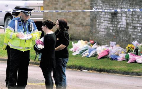 SHRINE: Floral tributes at the site where three members of the same family died in a suspected arson attack