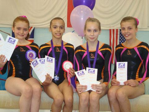 SUPER PERFORMANCES: Valleys Gymnastics Academy members Niya Hewitt, Macey Champman, Ellys Connor and Beth Wheeler who excelled in the Alpha Factor Invitational event