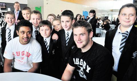 EXCITING: Newport Gwent Dragons Toby Faletau and Dan Lydiate are surrounded by pupils at the official opening of Llanwern High School