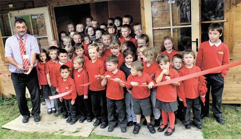 OUTSIDE LEARNING: Undy Primary School pupils and their head teacher Mark Gunn officially open their forest classroom, built using Parents and Teachers Association funds and donations