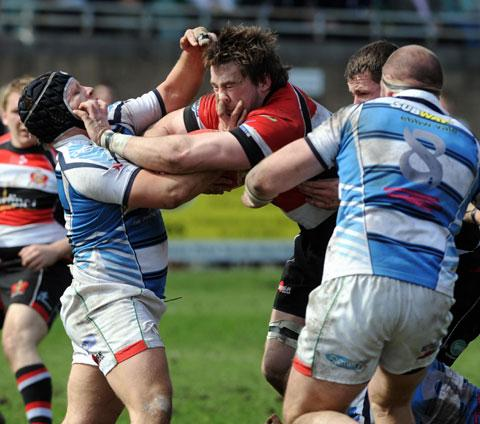 FIERCE CONTEST: Morgan Allen, then of Pontypool and now of the Ospreys, fends off Ebbw Vale stalwart Mathew Williams in the Premiership clash between the Gwent rivals at Eugene Cross Park in 2010