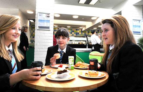 DINING IN STYLE: St Julian School pupils, from left; Isobel Powell, Brooke Robinson and Anita Connors, enjoy St Julian's School's new Aspire Cafe