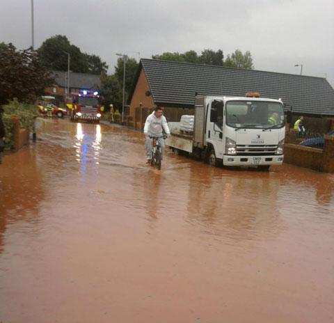 EARLY MORNING DELUGE: Flooding yesterday in Monmouth