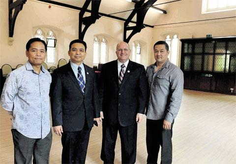 TRANSFORMATION: From left, head deacon Jesus Winston Lacsamana, resident minister Gerado Aliermo, district minister Anthony Smith, and fourth head deacon Nonilon Lucero in the refurbished hall of the Iglesia Ni Cristo in Newport