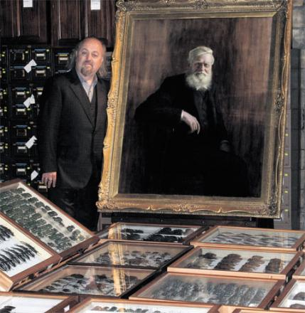 APPEAL: Comedian Bill Bailey is spearheading an appeal to raise money for a statue of Usk-born scientist Alfred Russel Wallace. He is pictured with some of the scientist's specimens at the Natural History Museum, London. PIC: Janet Beccaloni