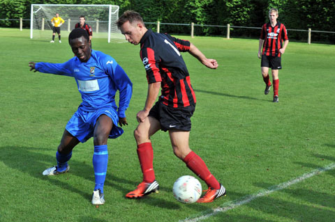 WEEKEND ACTION: Goytre's Callum Miles, right, wins the ball during his side's 3-0 home win over Caldicot