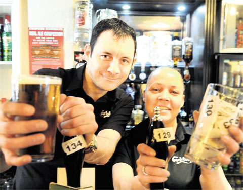 PRIZE ALE: Landlord and landlady Steve Harding and Lisa Thomas at the Windsor Castle pub are giving patrons a chance to creatre their own al