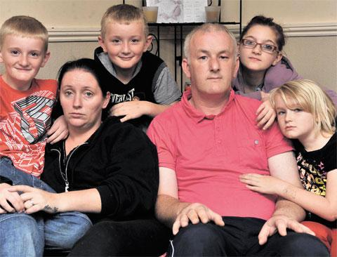 FORCED TO FLEE: Donna and Andrew Griffiths with four of their six children, from left, Andrew, ten, Iestyn, eight, Rhiannon, 12, and Ellie-Mae, six